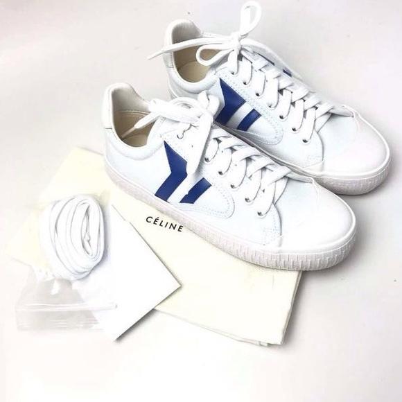 White Sneaker With Blue Stripe